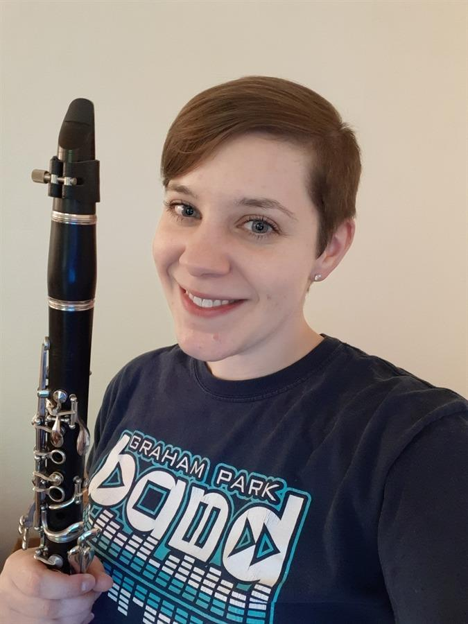 Picture of Ms. Fessner holding a clarinet